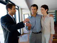 Couple receiving their house keys