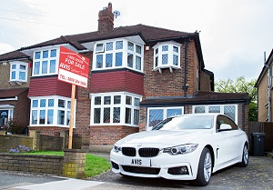 Can a posh car on the driveway help you sell your home?