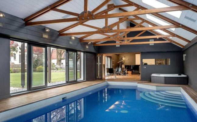 7 homes with wonderful swimming pools property blog for Houses with swimming pools inside for sale
