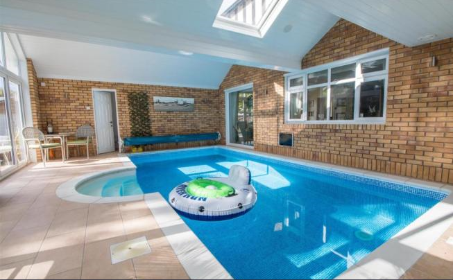 Weu0027d Love To Be Relaxing In This Wonderful Swimming Pool With Views Of The  Spacious Garden From The Bi Folding Doors!