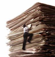 Man climbing up papers