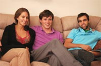 Group of students sitting on a sofa