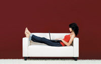 Lady sitting on a white sofa
