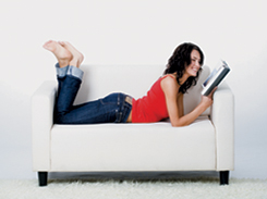 lady reading a book on the sofa
